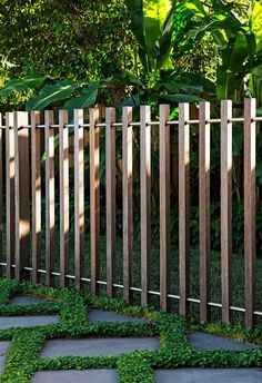 **Back garden** A spotted gum timber batten fence, threaded with stainless-steel rod, delineates the space between entertaining area and pet play lawn. fence, A Sydney backyard's relaxed resort-style makeover backyard design diy ideas