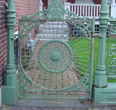 Vintage gate for front garden entry with arbor for roses to climb on.  Beautiful!!!