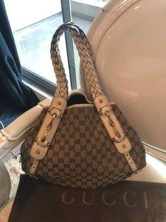 7ef4b8480cd Gucci Pelham Monogram White   Tan Canvas  Leather Hobo Bag. Hobo bags are  hot