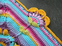 Crochet blanket with lots of texture, color and patterns.  Free from Ravelry.