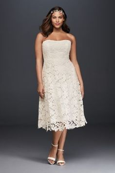 Delicate and sweet, a tea-length dress is a classic yet playful choice for either your wedding or rehearsal dinner. The large-scale cut-out Venise lace lends a free-spirited vibe to the ladylike silhouette.  Galina, exclusively at David's Bridal  Plus size  Lace  Back zipper, fully lined  Dry clean  Imported  Also available in regular and extra length