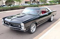 1967 GTO hotrod:  basic black with a swank red interior!!