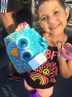 We recently heard of a girl, battling cancer, who loves owls. We sent her this cute owl hat. We are so happy Ashley's mother shared these pictures. Ashley's wearing the hat Roxann, one of our crocheters, made for her. It looks like she liked the other cute things too.