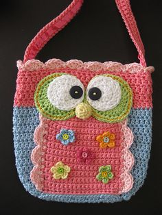 CrackerjackKnits' Little Girl's Owl Purse pattern for $5.20 at ravelry,com