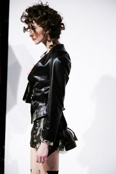 Black leather, collarless jacket at Vivienne Westwood AW14 LFW. More images at: http://www.dazeddigital.com/fashionweek/womenswear/aw14