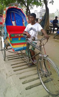Rickshaw driver . Dhaka Bangladesh