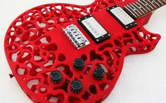 Red Atom 3D Printed Guitar: This Les Paul-style guitar features a wooden core — with a choice of Mahogany, Alder or Mable — and the body can be printed in a variety of colors.