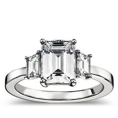 Emerald Cut With Trapezoid Side Stones via Glamour.com.