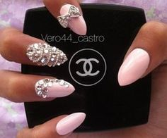Chanel pink pointed nails with bow and jewls