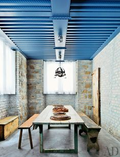 blue industrial ceiling in a rustic space