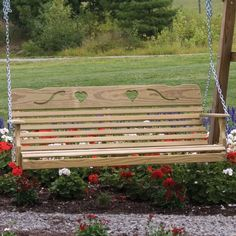 This large porch swing features a cute heart cut-out pattern in the backrest. This wooden porch swing is designed and handcrafted by skilled Amish cra