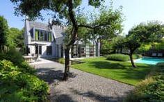 Moderne tuinarchitectuur in luxe tuin: moderne Tuin door Stoop Tuinen