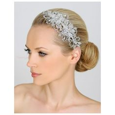 Showcasing the classic beauty of Swarovski crystal, this elegant bridal headpiece has gorgeous floral side detail accented with leaves made of hundreds of tiny silver beads.