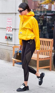 Kendall Jenner: Givenchy sunglasses; Adidas by Stella McCartney jacket; Louis Vuitton bag