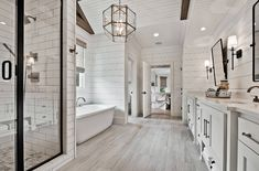 Welcoming craftsman style home with farmhouse touches in Arkansas - - This beautiful craftsman style home was designed by Celtic Custom Homes, located along Clear Creek in Fayetteville, Arkansas. Shiplap Bathroom Wall, Bathroom Interior, Shiplap Ceiling, Wood Tile Bathroom Floor, Bathroom Niche, Shower Bathroom, Bathroom Signs, Bathroom Shelves, Bathroom Fixtures