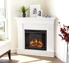 The Real Flame Chateau Corner Electric Fireplace is the perfect decoration for y… - Wood Burning Fireplace Inserts Gel Fireplace, Farmhouse Fireplace, Fireplace Inserts, Fireplace Design, Fireplace Ideas, Fireplace Cover, Limestone Fireplace, Black Fireplace, Small Fireplace