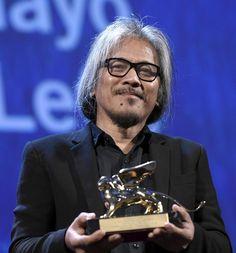 "Filipino film maker Lav Diaz holds the Golden Lion award for his movie "" Ang…"