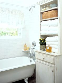 """An antique hutch serves as bathroom storage. The wood is protected from splashes by a marine-quality clear varnish."""