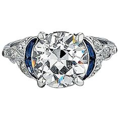 Art Deco 4.10 Carat Diamond, Sapphire, and Platinum Ring. This platinum art deco engagement ring features a 4.10ct old European-cut center diamond. It is G color, VS2 clarity, and is accompanied by a GIA report. There are also 0.25 carats total weight of accent diamonds and four custom-cut blue sapphires. c 1920s