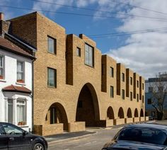 "Peter Barber includes ""cosy"" arched entrances at east-London housing scheme"