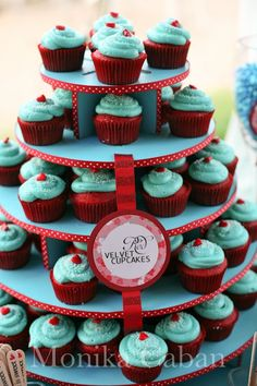 love the idea of a red velvet cupcake just not the 2 colors together. i would do teal icing and silver holders.