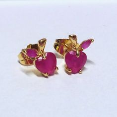 ($1.50) New Adorable Apple heart earrings Brand new pair of pierced stud earrings.  Never worn.  Red Apple shaped heart gem earrings.. So cute..   Gold tone.  Ruby-red colored crystals (not real ruby).   ------------------------------------------------------------------  PROMOTION: THIS ITEM CAN BE JUST (( $1.50 )) IF YOU BUNDLE $15 OR MORE TOTAL IN ITEMS FROM MY SHOP (AFTER DISCOUNTS). JUST ASK ME TO BUNDLE SEPARATELY. NO OTHER DISCOUNTS ALLOWED. Jewelry Earrings