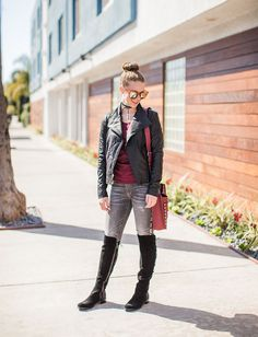 Bella Bucchiotti of xoxoBella is Wilson's Leather jacket, Michael Kors boots, Driftwood embroidered jeans and a Rebecca Minkoff bag.