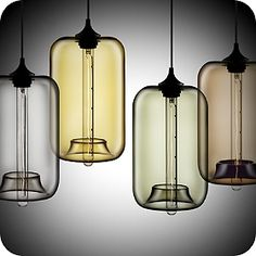These simple, beautiful glass light fixtures are incredibly beautiful, especially when ganged together in multiples. Pod Modern Pendant Light by Niche Modern