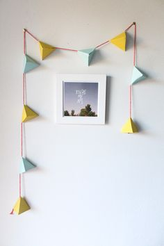 DIY geometric garland...they suggest filling it with candy for kids on Easter, but I think that this would be a good simple decorative accent also!