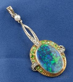 Edwardian Black Opal, Demantoid Garnet, and Diamond Pendant, bezel-set with an opal tablet measuring approx. 16.45 x 11.80 x 2.17 mm, framed by demantoid garnets, old single, and old European-cut diamond melee, seed pearl bail, platinum-topped gold mount, lg. 1 3/4 in.