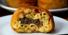 Macaroni and cheese is as delicious on it's own but studded with bacon and stuffed with a burger patty...these are incredible. Fried until golden brown, the macaroni has just enough cheese to emulate a bacon cheese burger! A perfect solution when you can't decide between mac and cheese or a…
