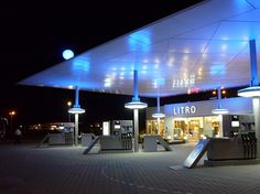Litro Gas Station, Building of the Week - Saffron Brand Consultants Roof Structure, Shade Structure, Filling Station, Stationary Design, Branding, Building Art, Futuristic Architecture, Gas Station, Car Wash