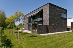Black brick villa features chic Scandinavian charm, designed by architect Gerth Wingård.