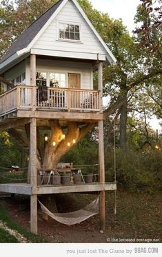 This is a live-able tree house. I love the hammock at the bottom, what a great use of space!