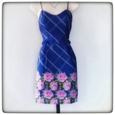 Royal Blue Print Sundress Royal blue sundress w/rose print bordering the hem, has ajustable straps, two side pockets, one inch ruffle detail at the waist and a brass color exposed zipper in the back.  Great condition.  100% polyester. Xhilaration Dresses Mini