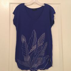 Blue Top w/ Leafy design Cute top, the leaves have peek a boo holes that show some skin toward the bottom. Forever 21 Tops Blouses