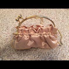 La Regale Gold Evening Bag La Regale gold evening bag. Has cute knob closure and strap. Inside has a pocket. Like new. Used once. Great for evening wear or wedding or prom. La Regale Bags Shoulder Bags