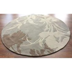 @Overstock - This rug is crafted with easy-to-clean synthetic fiber that prevents shedding, unlike wool. This rug features a modern design that will bring a rejuvenated look to any decorative scheme.http://www.overstock.com/Home-Garden/Handmade-Alexa-Pino-Emblem-Beige-Floral-Rug-6-Round/5199437/product.html?CID=214117 $115.19