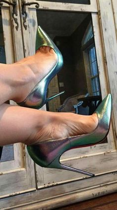 Silver pumps, arches, and toe cleavage