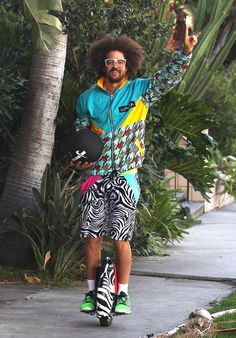 Life update: Redfoo from LMFAO has a motorized unicycle that matches his shorts.   Here's That One Dude From LMFAO Riding An Electric Unicycle Around His Neighborhood