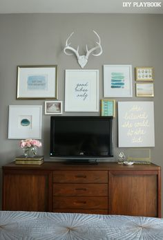 Surround your bedroom TV with a chic gallery wall. We love this mix of frames in this one. Such a great idea for a bedroom.
