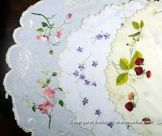 Society Silk: sampler of 3 different table toppers with wild roses, violets and strawberries.