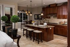 Rich, dark cabinets, make a kitchen feel warm and elegant! This kitchen is at Vistas at Skytt Mesa in Solvang, CA!