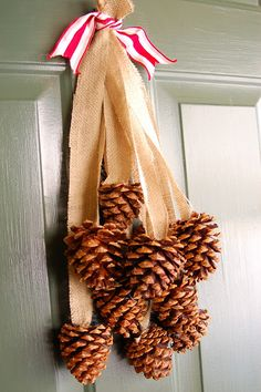 hot glue strips of burlap to cinnamon pine cones, gather with a ribbon and hang