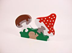 Wooden Toy Mushrooms Waldorf Learning toy Wooden Puzzle Toys for Kids Baby Toy Natural Puzzle toy consists of: 8 parts Colourful wooden pieces help develop hand-eye coordination, matching skills as well as fine motor skills.Wooden puzzle toys are both fun and educational. This toy is made out of beech wood and coloured with child friendly, water based paint.  Age: 2-3 years old and over  Size: 13 * 18.5 * 1.5 cm (5.1 * 7.3 * 0.6inches)  The product is fully processed to avoid rough spots…