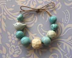 Handmade Ceramic Beads with Bird and Egg in Duck Egg Blue.