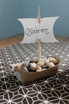 Cute idea for nautical theme party. I would fill with candy rather than rocks