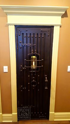 Iron Lion entries - Pantry Door - Home Remodel - Speakeasy - Dungeon Style Door