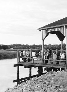 Guests enjoy drinks on the dock. (Photo Credit: Marni Rothschild) #SouthernWeddings