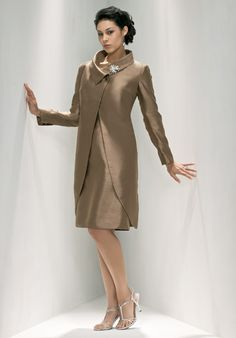 This winter mother of the bride dress features a long sleeve coat with a very interesting collar. This beautiful bronze colored mother of the bride suit works for many formal special occasions. You can gather more  mother of the bride dress inspiration at http://www.dariusfashions.com/product-category/mother-of-the-bride-dresses/